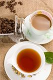 Coffee and tea on linen background Stock Images