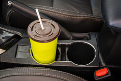 Coffee or tea mugs green placed on the vehicle console in modern luxury car. Interior Stock Images