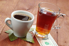 Coffee, tea and one dollar Stock Image