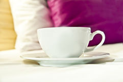 Coffee or tea served to bed. Cup of coffee/tea served directly to bed. Good morning Royalty Free Stock Images