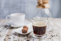 Coffee, cup of tea, two coconut sweet and a bottle. Coffee, tea, two coconut sweet and a bottle royalty free stock photos