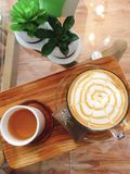 Coffee and tea on wooden plate. stock photo