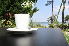 coffee on the terrace table with sea stock photo