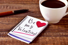 Coffee and text be my valentine in a notebook Stock Photos