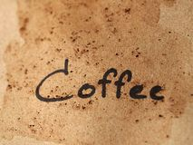 Coffee text on dirty paper Royalty Free Stock Photos