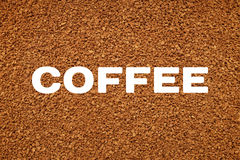 COFFEE text over background of freeze dried granules. COFFEE text over abstract background of freeze dried granules Royalty Free Stock Photo