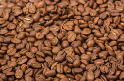 Coffee texture. coffee beans as background wallpaper. arabica cofee bean. Coffee texture. Roasted coffee beans as background wallpaper. Beautiful arabica real stock photos