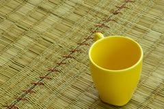 Coffee textured yellow, empty glass, La Mick. Stock Image