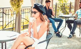 Coffee thats always the way you like. Woman enjoy drinking espresso or cappuccino. A coffee break for a snack. Pretty royalty free stock photo