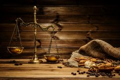 Coffee theme still-life. Coffee theme with brass scales still-life on wooden table royalty free stock photo