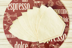 Coffee themed round tray and coffee filters Royalty Free Stock Images