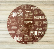 Coffee themed round tray on the wooden background Royalty Free Stock Image
