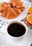 Coffee with three crescent rolls Royalty Free Stock Photos