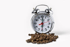 Coffee Time. Old clock with coffee beans Royalty Free Stock Photography