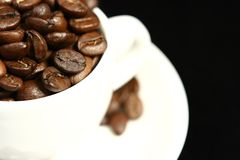 Coffee time. Cup of coffee with beans isolated Royalty Free Stock Photo