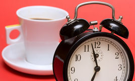 Coffee time. Morning coffee and clock (red background Royalty Free Stock Photography