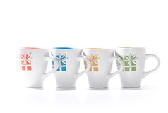 Coffee time. Four coffee cups with different design on the them Royalty Free Stock Photos