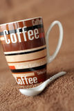 Coffee time. Picture a brown coffee mug Royalty Free Stock Photos