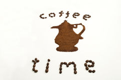 Coffee time. Coffee pot designed in beans and ground coffee on white background Stock Photo