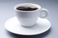 Coffee time. A ceramic cup full of black coffee Stock Photos