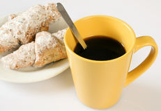 Coffee time. A cup of coffee with a spoon. on a plate two cakes Royalty Free Stock Photos