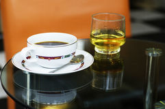 Coffee time. A cup of coffee on table Royalty Free Stock Photos