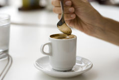 Coffee Time. Moving the sugar in coffee Stock Image