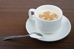 Coffee time. Cup of coffee in white mug on the saucer with spoon Royalty Free Stock Images