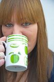 Coffee time. A close up  image of an attractive girl thinking and drinking morning coffee in a mug Royalty Free Stock Photography