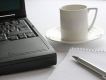Coffee Time. Coffe cup and laptop computer royalty free stock photography