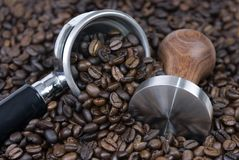 Coffee Time 3. Roasted coffee surrounds a tamper and filter...it's coffee time Royalty Free Stock Images