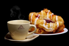 Coffee time. With a hot buns. (black background Stock Photography
