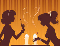 Coffee time. Two girls having coffee together Stock Images