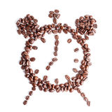 Coffee time. Alarm Clock of coffee beans on a white background Royalty Free Stock Images