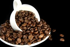 Coffee time background. Coffee beans on black  background Stock Images