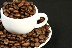 Coffee time background. Cup of coffee with beans background Royalty Free Stock Images