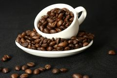 Coffee time background. Cup of coffee with beans background Royalty Free Stock Image