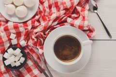 Coffee time. Treats and coffee on checkered cloth Royalty Free Stock Images