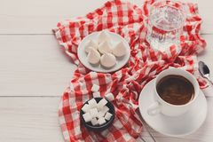 Coffee time. Treats and coffee on checkered cloth Royalty Free Stock Photography