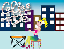 Coffee time. Blonde girl is having a coffee in town Stock Images