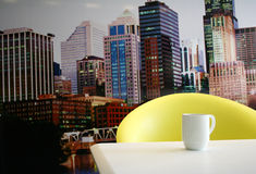 Coffee Time City. A coffee mug and table over looking a city Royalty Free Stock Image