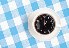 Coffee time concept. Top view of coffee cup with clocks Stock Photo