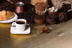 Coffee time concept. Still-life with coffee, cup with saucer, coffee mill, sac with beans and spices. Coffee time concept Stock Images