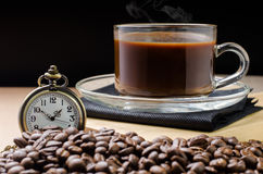 Coffee time concept with vintage pocket watch on coffee beans ba Royalty Free Stock Photo