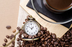 Coffee time concept with vintage pocket watch on coffee beans ba Royalty Free Stock Photography