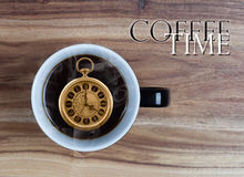 Coffee Time Concept - watch inside mug 4 o'clock Royalty Free Stock Images