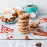 Coffee time with cookies, xmas decor. Cinnamon and nuts, Christm Stock Images