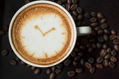 Cup of fresh cappuccino with clock sign. Coffee time ,Cup of fresh cappuccino with clock sign Stock Images