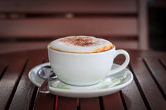 Coffee time. A cup of hot Cappuccino Royalty Free Stock Images