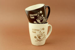 Coffee time cups brown background.  Stock Photos